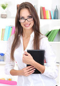 Young business woman with notebook at office — Stock Photo