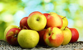 Juicy apples, on green background — Stock Photo