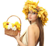 Beautiful young woman with yellow autumn wreath and basket with flowers, isolated on white — Stock Photo