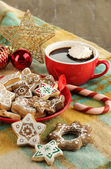 Christmas treats on plate and cup of coffe on plaid close-up — Stock Photo