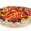Colorful autumn berries on wicker mat isolated on white - Stock Photo
