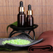 Aromatherapy setting on brown bamboo background - Stock Photo