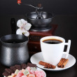Cup of coffee with rahat delight, coffee pot and coffee mill on wooden table — Stock Photo