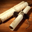 Stock Photo: Old scrolls, on wooden background