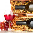 Stock Photo: Wooden case with wine bottle, wineglass and grape isolated on white
