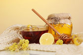 Healthy ingredients for strengthening immunity on warm scarf on yellow background — Stock Photo