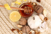 Healthy ingredients for strengthening immunity on warm scarf close-up — Stock Photo