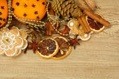 Composition of christmas spices and tangarines, on wooden background — Stock Photo