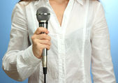 Female with microphone, close up — Stock Photo