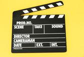 Placa de badajo película sobre fondo de color — Foto de Stock