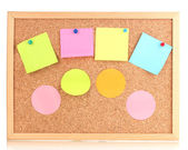 Colorful sticky notes on board isolated on white — Stock Photo