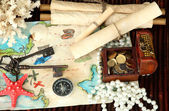 Map of treasures on dark wooden background — Stock Photo