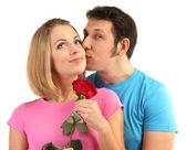 Loving couple with rose isolated on white — Stock Photo