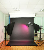Empty photo studio with lighting equipment — Foto de Stock