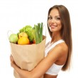 Beautiful young woman with vegetables and fruits in shopping bag , isolated on white — Stock Photo #18603689