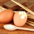 Boiled eggs on wooden background — Stock Photo #18603753