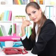 Young pretty business woman with phone and notebook working at office. Contact us — Stock Photo #18603893