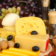 Various types of cheese on wooden board — Stock Photo #18604935