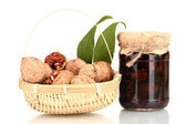 Jam-jar of walnuts and a basket with walnuts — Stock Photo