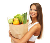 Beautiful young woman with vegetables and fruits in shopping bag , isolated on white — Stock Photo