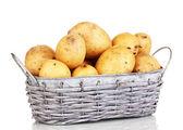Ripe potatoes on basket isolated on white — Stock Photo