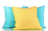 Blue and yellow bright pillows isolated on white — Stock Photo