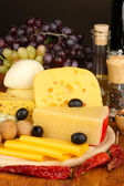 Various types of cheese on wooden board — Stock Photo