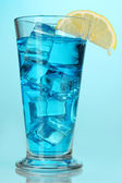 Blue Lagoon cocktail on blue background — Stock Photo