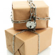 Stock Photo: Parcels with chains, isolated on white