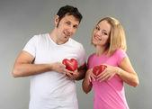 Loving couple on grey background — Стоковое фото