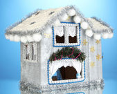 Decorated Christmas house on blue background — Stock Photo