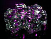 Ice cubes on dark purple background — Stock Photo