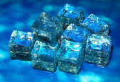 Ice cubes on color background — Stock Photo