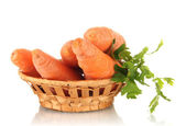 Carrots in basket isolated on white — Stock Photo