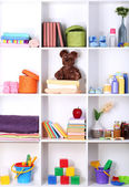 Beautiful white shelves with different baby related objects — Stok fotoğraf