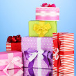 Colorful gifts on blue background — Stock Photo