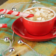 Cup of coffee with holiday candy on plaid close-up — Stock Photo #18659213