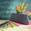 Back to school - blackboard with pencil-box and school equipment on table — Foto Stock