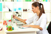 Young female scientist in laboratory — Foto Stock