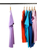Choice of clothes of different colors on wooden hangers, isolated on white — Stockfoto