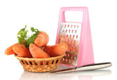 Carrots with grater isolated on white — Stock Photo