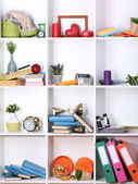 Beautiful white shelves with scattered different home related objects — Stock Photo