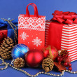 New Year composition of New Year's decor and gifts on blue background — Stok fotoğraf