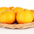 Stock Photo: Tasty mandarines on wicker mat isolated on white