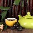 Chinese tea ceremony on bamboo table on bamboo background — Stock Photo