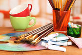 Artistic equipment: paint, brushes and art palette — Photo