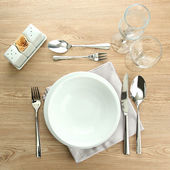 Table setting on wooden table — Stock Photo