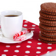 Chocolate cookies with creamy layer and cup of coffe isolated on white - Photo