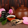 Stock Photo: Chinese tea ceremony on bamboo table on bamboo background
