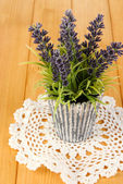 Decorative lavender in vase on wooden table close-up — Stock Photo